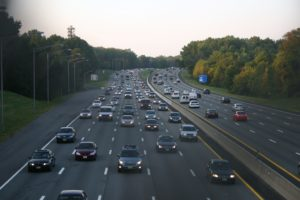 Motor traffic on Garden State Parkway, New Jersey, photographed in the evening. Most of the cars are southbound, moving from New York to the suburban homes in New Jersey.