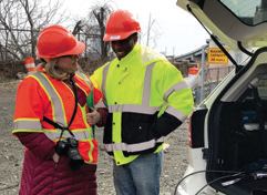 TRB senior program officer Christine Gerencher (left) and New Jersey DOT UAS pilot Koree Dusenbury (right) prepare for the flight demonstration.