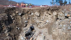 UAS Team in the field exploring the damage from rockfall along I-287