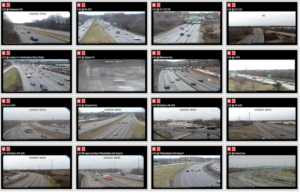 Image of 16 video feeds, each of a different stretch of highway, a video wall for traffic operations monitoring.